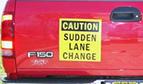 caution sudden lane change magnetic truck sign